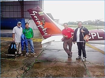 Hank Eriberto Yuri and manager by plane